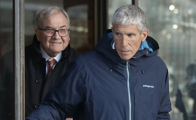 "William ""Rick"" Singer, front, founder of the Edge College & Career Network, exits federal court in Boston on  March 12, 2019. (AP Photo/Steven Senne)"