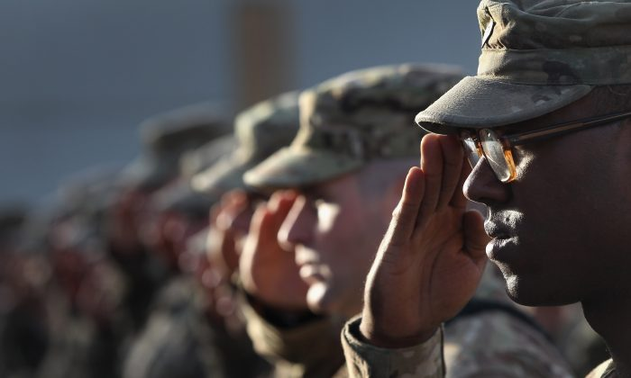 U.S. Army soldiers salute during the national anthem during an anniversary ceremony of the Sept. 11 terrorist attacks at Bagram Air Field, Afghanistan, on Sept. 11, 2011. (John Moore/Getty Images)