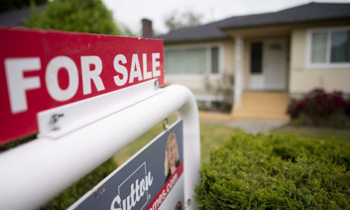 A real estate sign is pictured in Vancouver in this file photo. Home prices are down over 6 percent in the last six months. (The Canadian Press/Jonathan Hayward)