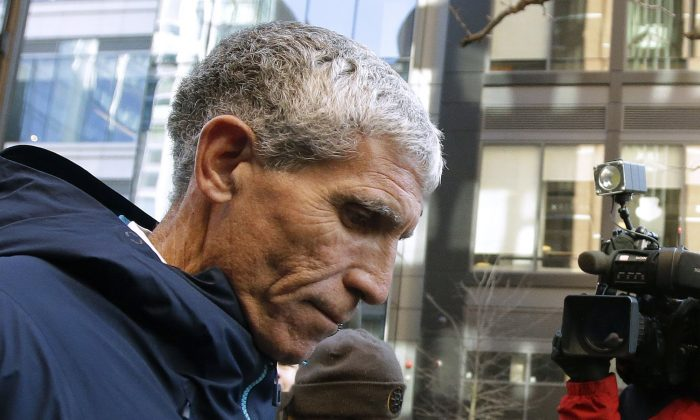 """William """"Rick"""" Singer founder of the Edge College & Career Network, departs federal court in Boston after he pleaded guilty to charges in a nationwide college admissions bribery scandal on March 12, 2019. (Steven Senne/AP Photo)"""
