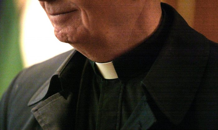 In this file image, the collar of a priest is seen at St. Adalbert Catholic Church March 29, 2002 in Chicago, IL. (Tim Boyle/Getty Images)