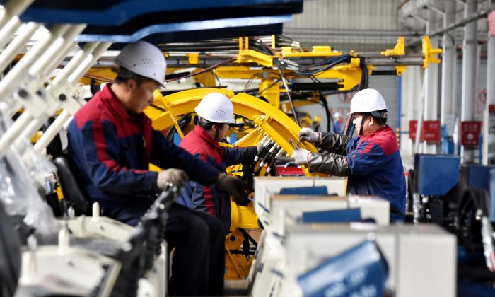 Employees work on a drilling machine production line at a factory in Zhangjiakou, Hebei Province, China on Nov. 14, 2018. (Reuters)
