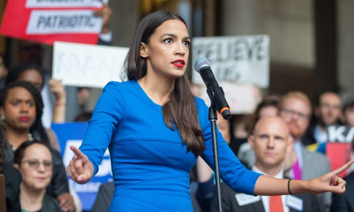 Then-New York Democratic congressional candidate Alexandria Ocasio-Cortez speaks at a rally in Boston, Massachusetts, on Oct. 1, 2018. (Scott Eisen/Getty Images)