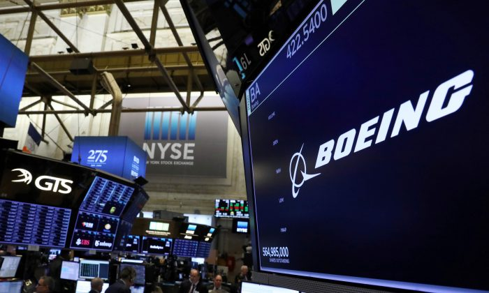 The company logo for Boeing is displayed on a screen on the floor of the New York Stock Exchange (NYSE) in New York City, on March 11, 2019. (Brendan McDermid/Reuters)