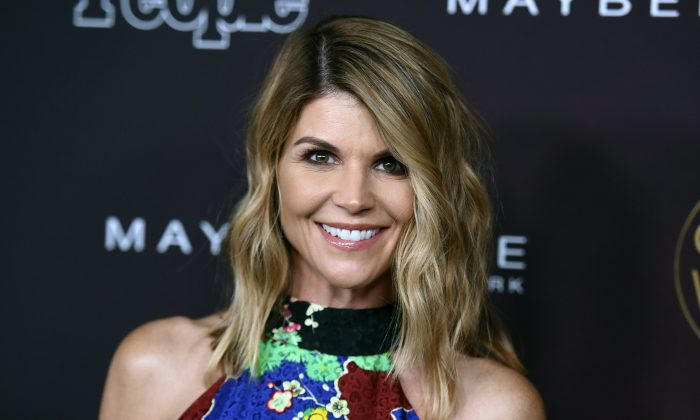 "Actress Lori Loughlin arrives at the 5th annual People Magazine ""Ones To Watch"" party in L.A., on Oct. 4, 2017. (Richard Shotwell/Invision/File via AP)"