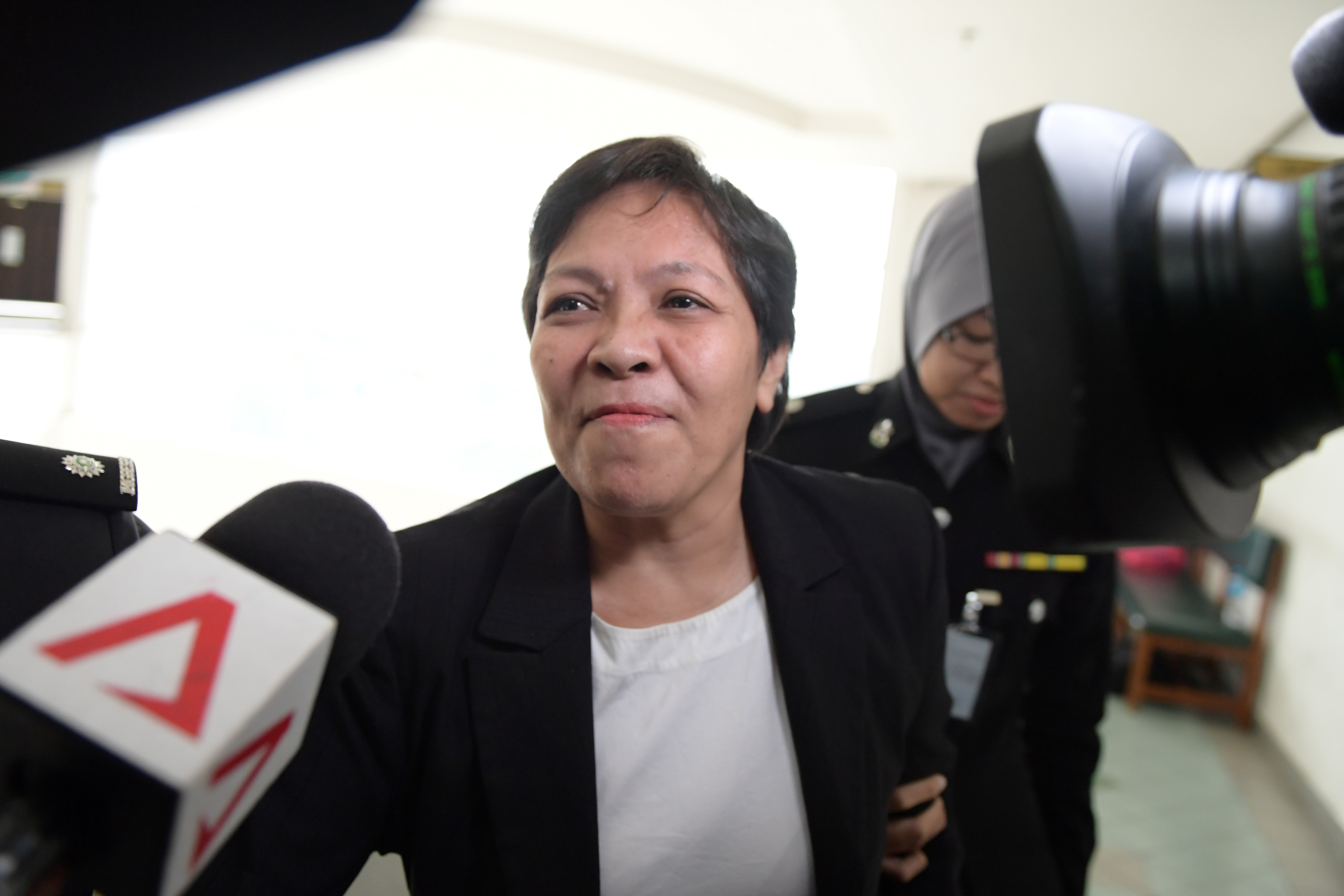Maria Elvira Pinto Exposto reacts after she was cleared of drug trafficking charges