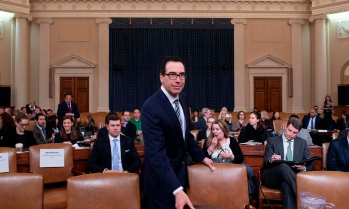 "Treasury Secretary Steven Mnuchin arrives to testify on ""The President's FY2020 Budget Proposal"" before the House Ways and Means Committee on Capitol Hill in Washington, DC, on March 14, 2019. (JIM WATSON/AFP/Getty Images)"
