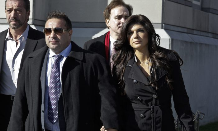 Teresa Giudice and her husband Giuseppe 'Joe' Giudice (L) leave Newark federal court in Newark, New Jersey, on Nov. 20, 2013. Joe finished serving a 41-month prison sentence on March 14, 2019, and was immediately transferred into the custody of Immigration and Customs Enforcement. (Kena Betancur/Getty Images)