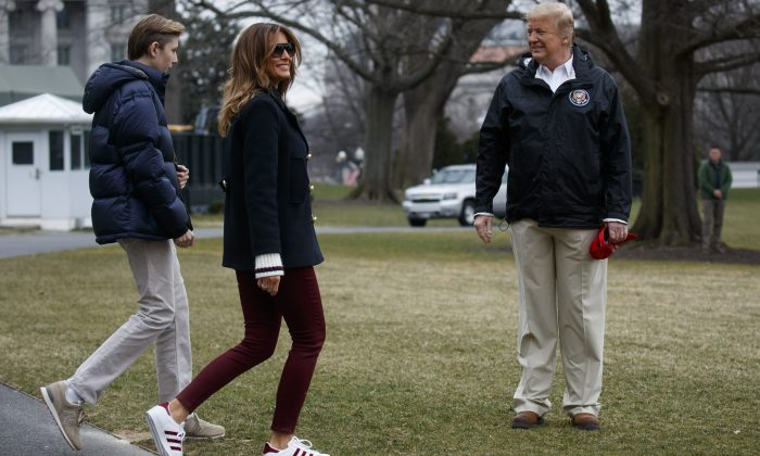President Donald Trump waits for his son Barron Trump, and first lady Melania Trump after speaking with reporters outside the White House in Washington before traveling to Alabama to visit areas affected by the deadly tornadoes on March 8, 2019. (Evan Vucci/AP Photo)