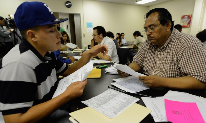 An illegal immigrant receives help filling in his application for the Deferred Action for Childhood Arrivals (DACA) program in Los Angeles on Aug. 15, 2012. (Kevork Djansezian/Getty Images)