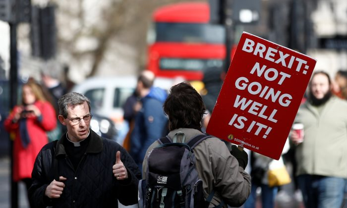 An anti-Brexit protester walks outside the Houses of Parliament in London on March 14, 2019. (Henry Nicholls/Reuters)