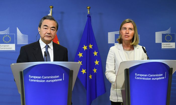 China's Foreign Minister Wang Yi (L) and EU foreign policy chief Federica Mogherini address a joint press conference at the European Commission in Brussels on June 1, 2018. (Emmanuel Dunand/AFP/Getty Images)