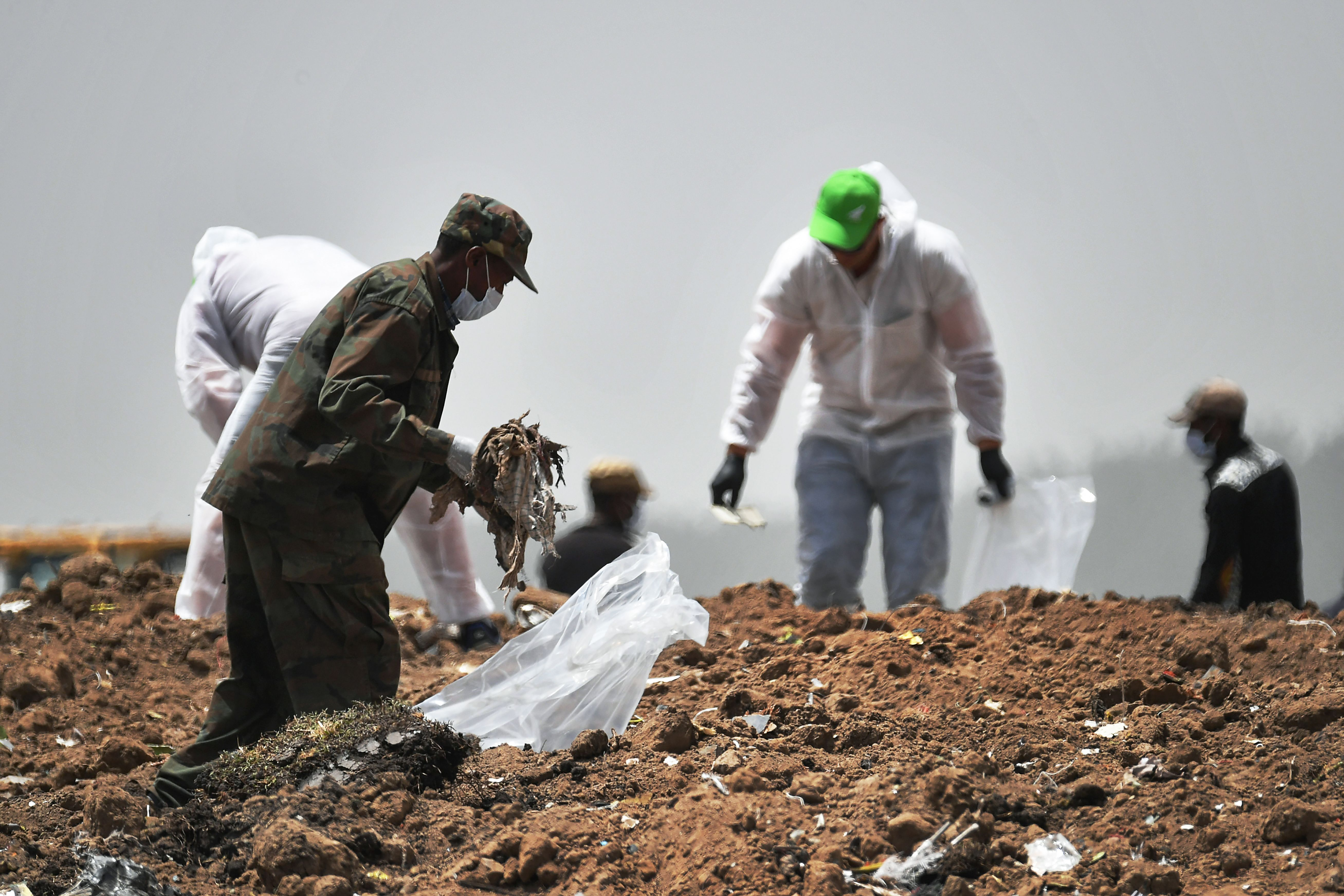 Forensics experts comb through the dirt for debris