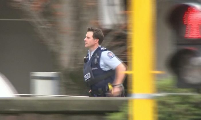 A police officer is seen after reports that several shots had been fired at a mosque in central Christchurch, New Zealand, on March 15, 2019. (TVNZ/via REUTERS TV)