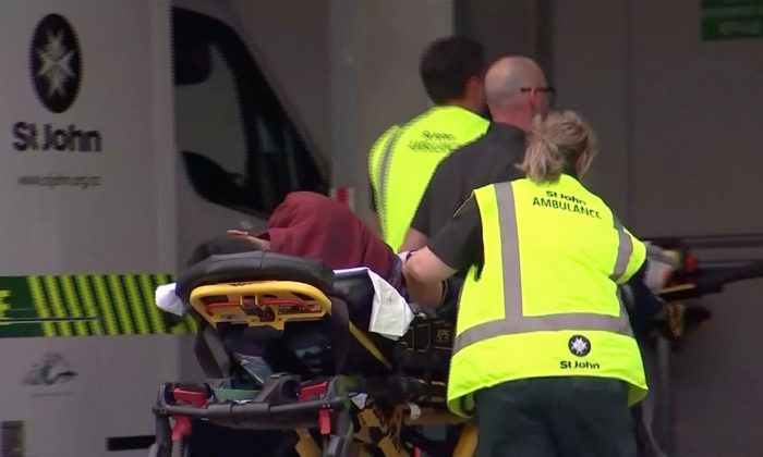 Emergency services personnel push stretchers carrying a person into a hospital, after reports that several shots had been fired, in central Christchurch, New Zealand on March 15, 2019. (TVNZ via Reuters TV)