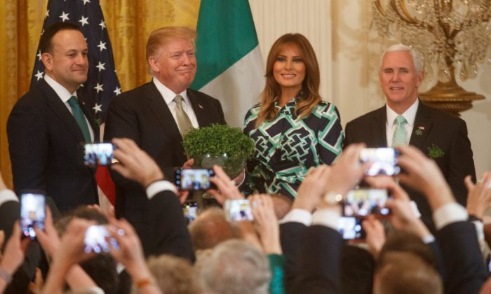 (L-R) Taoiseach Leo Varadkar of Ireland, President Donald Trump, First Lady Melania Trump, and Vice President Mike Pence pose for a photo during the Shamrock Bowl Presentation with Prime Minister of Ireland Leo Varadkar on March 14, 2019 at the White House in Washington, DC. (Tom Brenner/Getty Images)