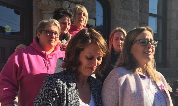 Andrea Gosse (right) leaves a St. John's, N.L. courthouse, on March 15, 2019, surrounded with supporters shortly after hearing the first-degree murder conviction of Trent Butt, found guilty of killing their five-year-old daughter Quinn almost three years ago. (Holly McKenzie-Sutter/The Canadian Press)