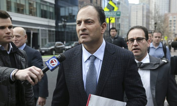 David Sidoo, of Vancouver, Canada, leaves following his federal court hearing in Boston on March 15, 2019. (Jonathan Wiggs/The Boston Globe via AP)