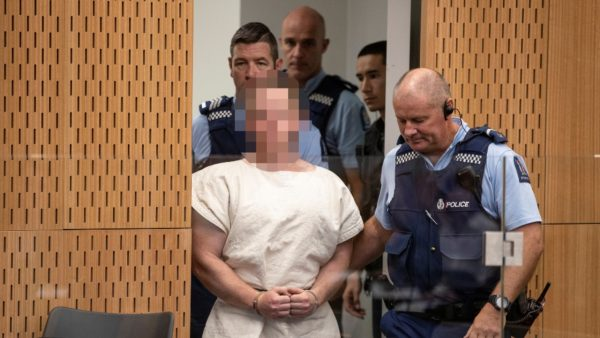 Brenton Tarrant, charged for murder in relation to the mosque attacks, is lead into the dock for his appearance