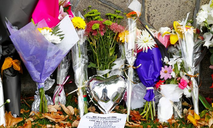 Flowers and signs laid at a memorial for victims of the Christchurch mosque attacks outside Masjid Al Noor in Christchurch, New Zealand, on March 17, 2019. (Jorge Silva/Reuters)