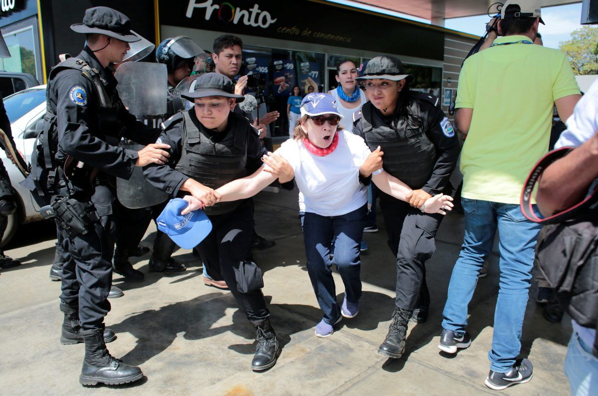 Riot police detain a demonstrator during a protest against the government of Nicaragua's President Daniel Ortega in Managua, Nicaragua