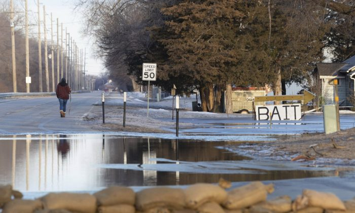 Sandbags line the intersection of Ridge Road and Military Avenue in Fremont, Neb., on March 16, 2019. (Kent Sievers/Omaha World-Herald via AP)