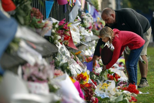 Mourners lay flowers