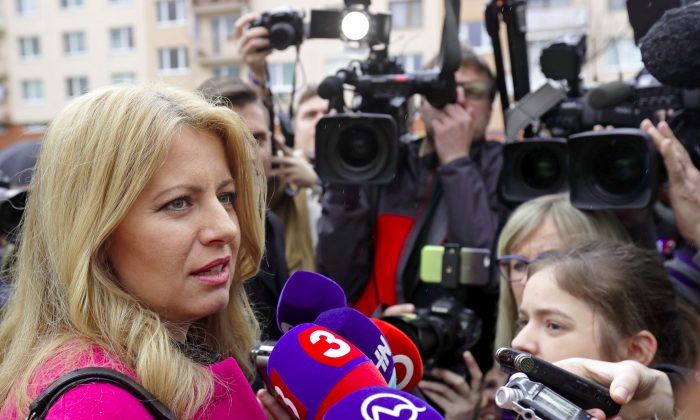 Slovakia's presidential candidate Zuzana Caputova speaks after casting her vote during the country's presidential elections at a polling station in Pezinok, Slovakia, on March 16, 2019. (David W Cerny/Reuters)