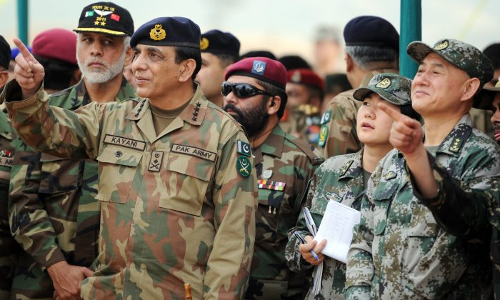 Pakistan's army chief General Ashfaq Kayani (L) and General Hou Shusen (R), Deputy Chief of  Staff of Chinese People's Liberation Army (PLA), watch the Pakistan-China military drill in Jhelum, Pakistan, on November 24, 2011.  (Aamir QureshiAFP/Getty Images)