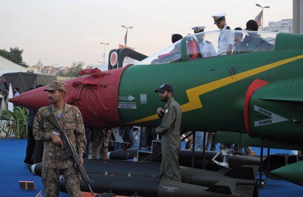 Pakistani soldiers guard a plane