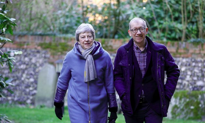 Britain's Prime Minister Theresa May and her husband Philip arrive at church in Sonning, United Kingdom, on March 17,  2019. (Henry Nicholls/Reuters)
