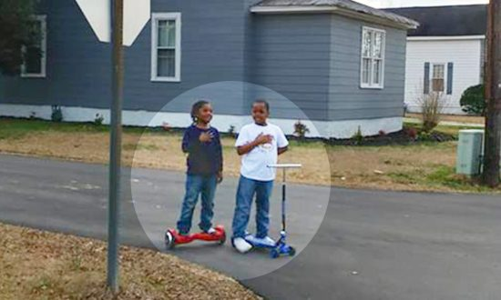 Boys Get Lauded for Stopping in the Middle of the Road to Honor the Raising American Flag