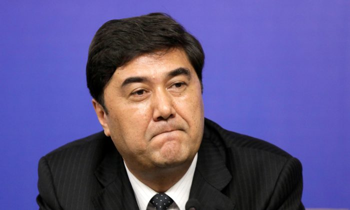 Nur Bekri, former governor of Xinjiang, attends a news conference during the annual session of China's rubber-stamp legislature, the National People's Congress, in Beijing on March 7, 2010. (Jason Lee/Reuters)