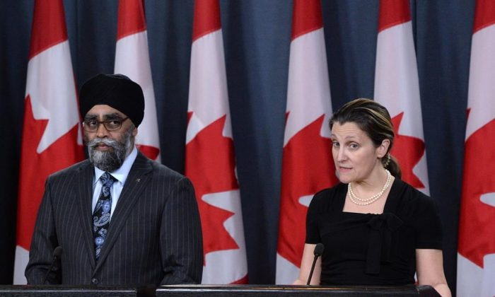Defence Minister Harjit Sajjan and Foreign Affairs Minister Chrystia Freeland make an announcement in Ottawa, on March 18, 2019 about Canada extending its military missions in Ukraine and Iraq, both of which were due to expire at the end of the month. (Sean Kilpatrick/The Canadian Press)