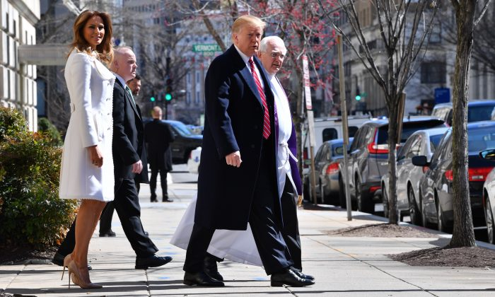 President Donald Trump and First Lady Melania Trump (L) with interim rector Bruce McPherson (R) as they leave St. Johns Episcopal church in Washington, on March 17, 2019. (Nicholas Kamm/AFP/Getty Images)