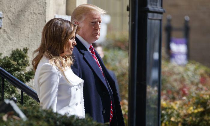 President Donald Trump and First Lady Melania Trump walk to their motorcade after attending service at Saint John's Church in Washington, en route to the White House, on March 17, 2019. (Carolyn Kaster/AP Photo)
