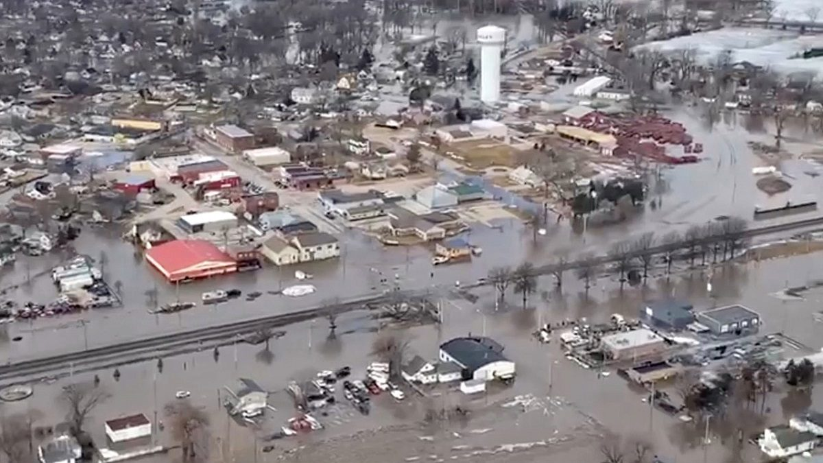 An aerial view of damaged buildings after a storm triggered historic flooding, in Valley, Nebraska