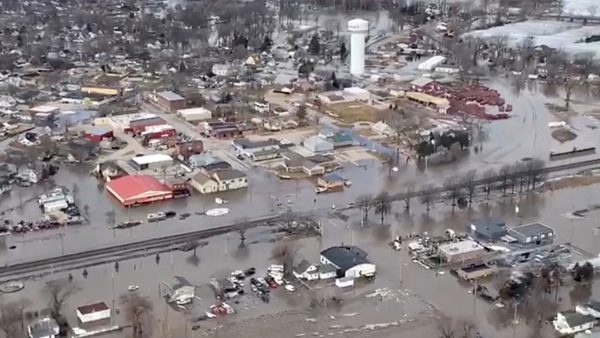 An aerial view of damaged buildings after a storm triggered historic flooding,