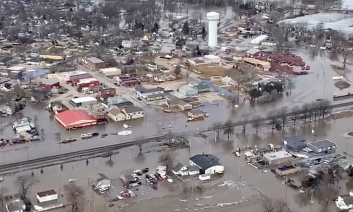An aerial view of damaged buildings after a storm triggered historic flooding, in Valley, Nebraska, in this still image from a handout video taken on Mar.16, 2019. (Office of Governor Pete Ricketts/Reuters)