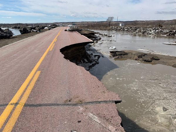 A damaged road is seen after a storm triggered historic flooding in Niobrara