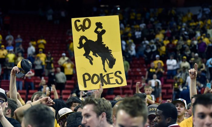 Wyoming Cowboys fans display a poster after the championship game of the Mountain West Conference basketball tournament against the San Diego State Aztecs at the Thomas & Mack Center in Las Vegas, Nevada, on March 14, 2015. (David Becker/Getty Images)