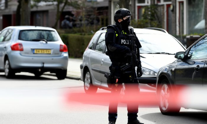 A policeman stands guard after a shooting in Utrecht, The Netherlands, on March 18, 2019. (Piroschka van de Wouw/Reuters)