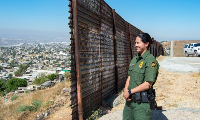 San Diego Border Patrol agent Tekae Michael at the eastern end of the U.S.-Mexico border barrier in Otay Mesa, San Diego, on July 12, 2017. The section of border wall was first constructed in 1991 to prevent vehicles from illegal crossings. (Joshua Philipp/The Epoch Times)