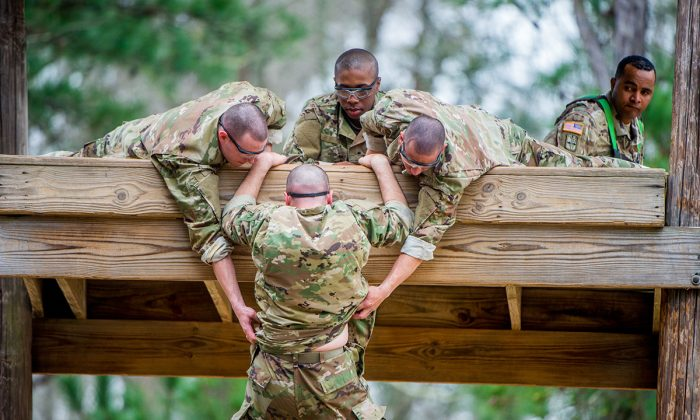 Trainees negotiate a confidence course on Sand Hill at Fort Benning, Ga., on Feb. 27, 2019.  Benning is the first stage of Ranger School, where soldiers undertake an intense training program. (U.S. Army photo by Patrick Albright)