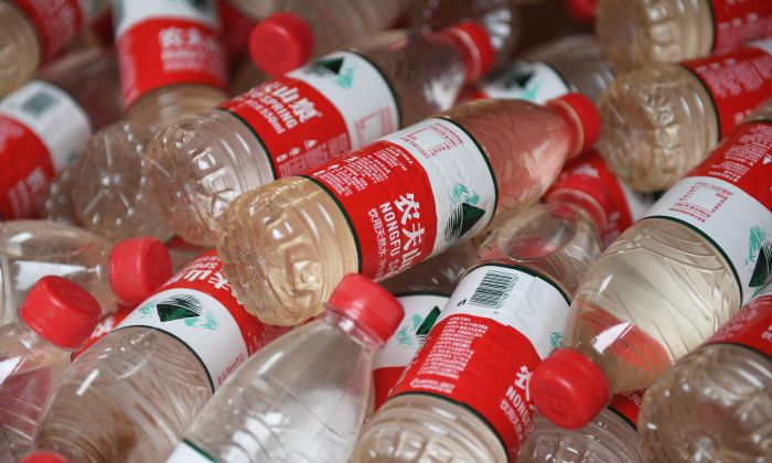 The polluted water in mineral water bottles in Beijing on July 12, 2018. (GREG BAKER/AFP/Getty Images)