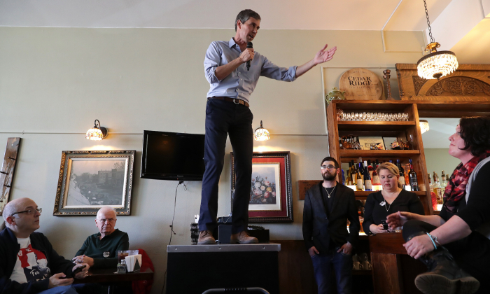Democratic presidential candidate Beto O'Rourke answers questions from voters during his second day of campaigning for the 2020 nomination at The Sing-A-Long Bar and Grill in Mount Vernon, Iowa, on March 15, 2019.(Chip Somodevilla/Getty Images)