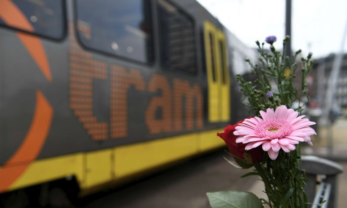 Flowers are placed at the site of a shooting in Utrecht, the Netherlands, on March 19, 2019. (Piroschka van de Wouw/Reuters)