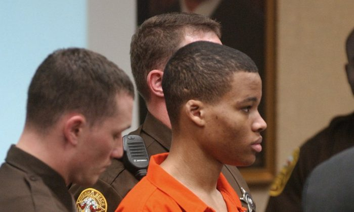 Lee Boyd Malvo listens to court proceedings during the trial of fellow sniper suspect John Allen Muhammad in Virginia Beach, Va., on Oct. 20, 2003. (Martin Smith-Rodden/AP Photo)