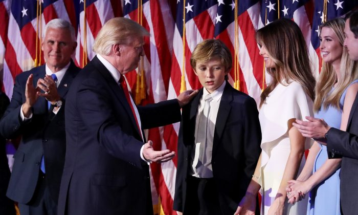 Republican president-elect Donald Trump acknowledge his son Barron Trump (C) after delivering his acceptance speech at the New York Hilton Midtown in the early morning hours in New York City, on Nov. 9, 2016. (Joe Raedle/Getty Images)