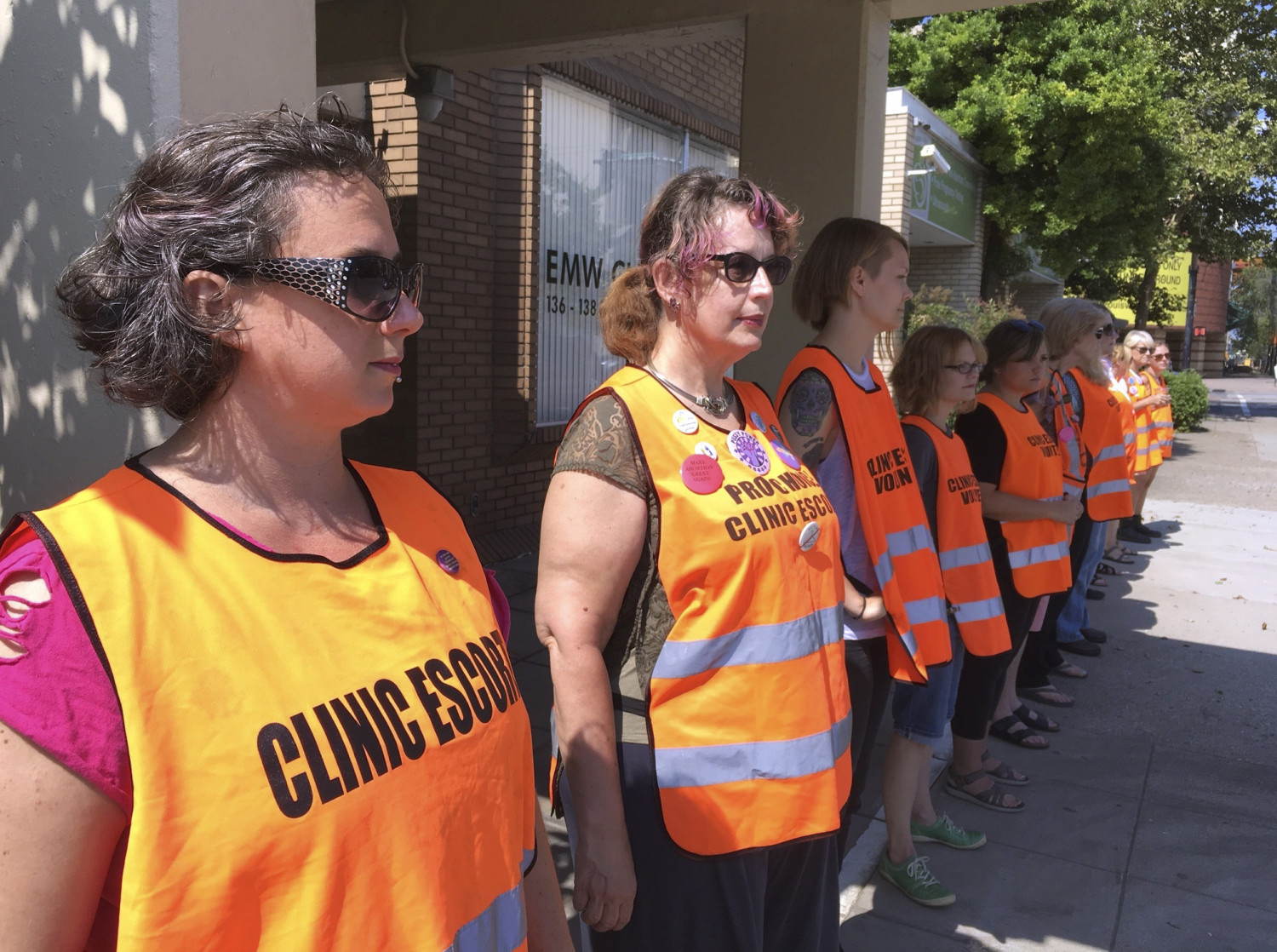 In this July 17, 2017 file photo, escort volunteers line up outside the EMW Women's Surgical Center